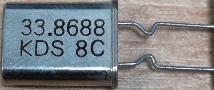 Krystal 33,8688kHz, HC-49/U